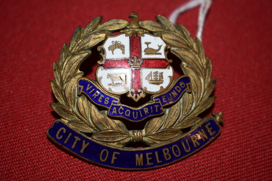 CITY OF MELBOURNE GILT AND ENAMEL HAT BADGE