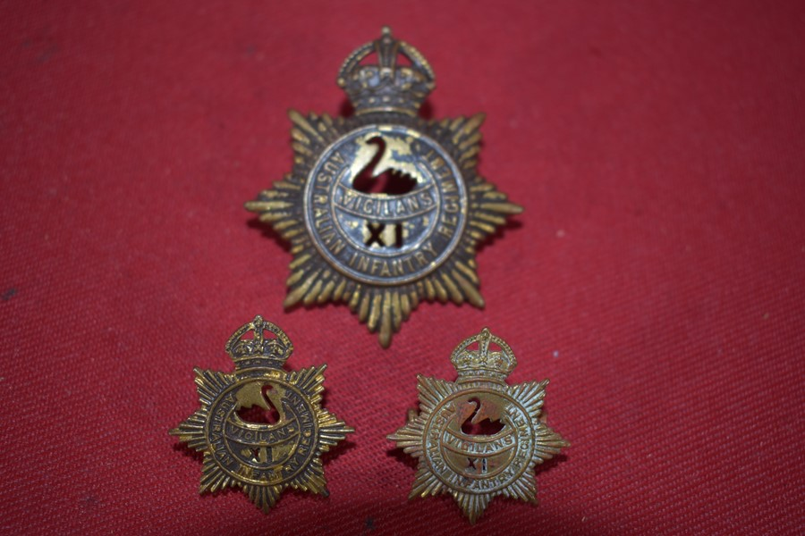 AUSTRALIAN ARMY HAT AND COLLAR BADGE SET 11 BN 30-42 VOIDED.