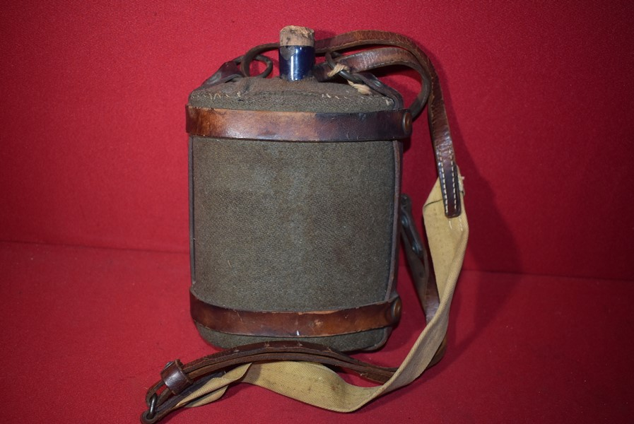 WW2 AUSTRALIAN WATER CANTEEN WITH LEATHER CARRIER STRAPS DATED 1942-SOLD