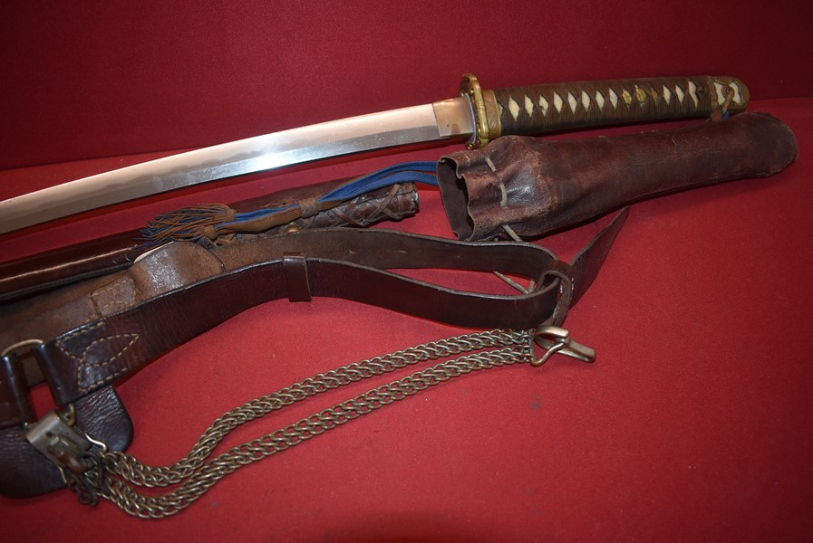 WW2 JAPANESE OFFICERS SAMURAI SWORD COMPLETE WITH BELT, HANGERS, TASSEL AND FOUL WEATHER COVER.