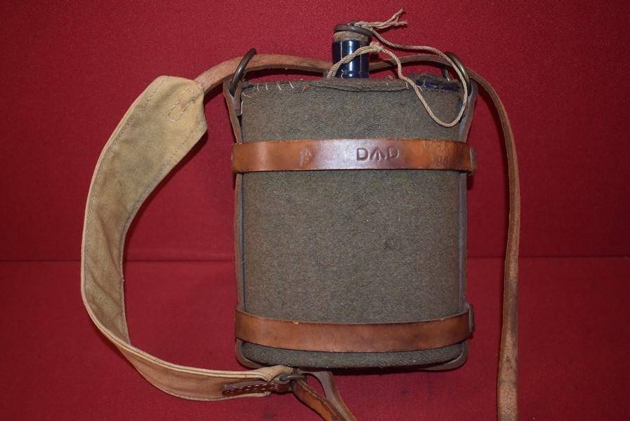WW2 AUSTRALIAN ISSUED WATER CANTEEN AND LEATHER CARRIER