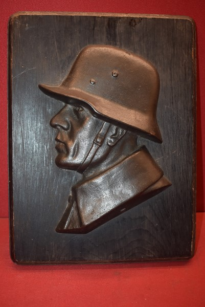 WW1 GERMAN SOLDIER  CAST IRON ON WOOD PLAQUE-SOLD